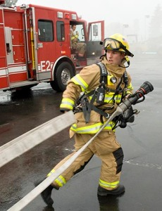Firefighter pulling hose